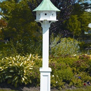 pole with a copper roofed birdhouse on it